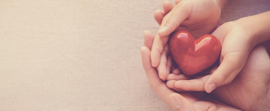 Hands holding hearts together